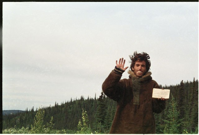 "The last photograph ever taken by McCandless, shortly before his death. The card in his hand reads: ""I HAVE HAD A HAPPY LIFE AND THANK THE LORD. GOODBYE AND MAY GOD BLESS ALL!"""