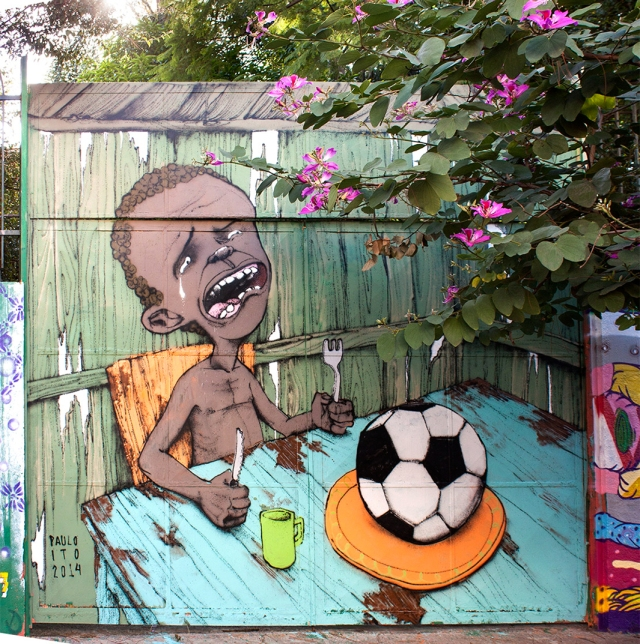 A mural by Brasilian artist Paulo Ito protesting the perverse reality of funding the world cup, Source: Slate.com