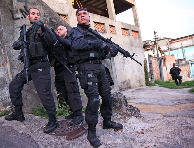 """Police """"pacify"""" a favela ahead of the World Cup. Source: Mario Tama/Getty Images"""