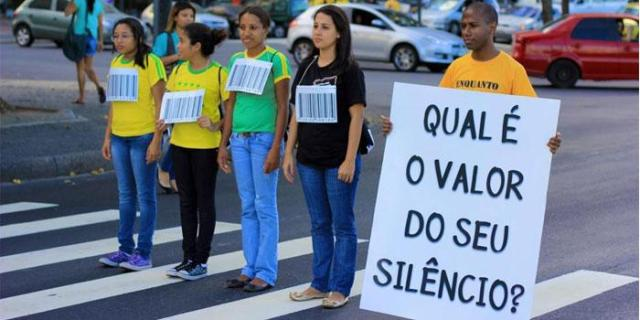 """A campaign to raise awareness to human trafficking in Brazil (in the sign you can read """"How much is your silence worth?) - credits to www.salvationarmy.org"""