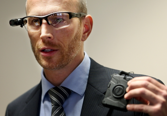 Gary Schiff, of the Minneapolis City Council, demonstrates body cameras being proposed in the city. This is a process now starting all across america. Source: Joel Koyoma/Star Tribune