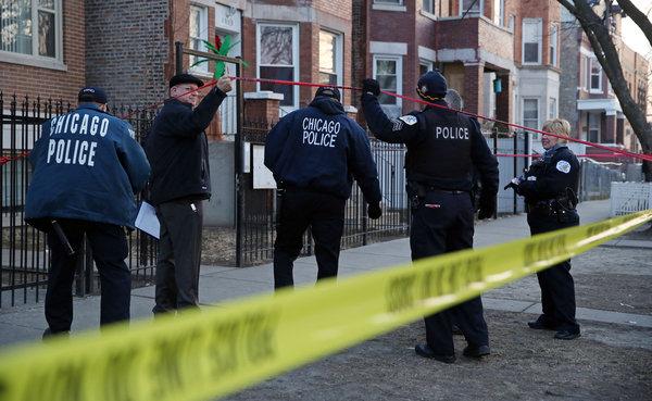 Police investigators cross caution tape at Chicago shooting. Source: John J. Kim / Chicago Tribune