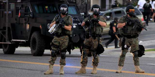 Police in riot gear in Ferguson on August 11th. Source: AP Photo/Jeff Roberson