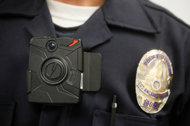 Officer in LA wearing a body camera. Source: Damian Dovarganes/AP
