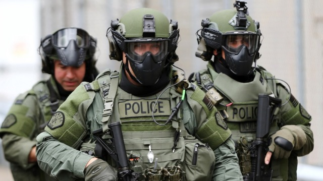 Swat team in Cambridge. Source: Jonathan Wiggs/The Boston Globe via Getty Images