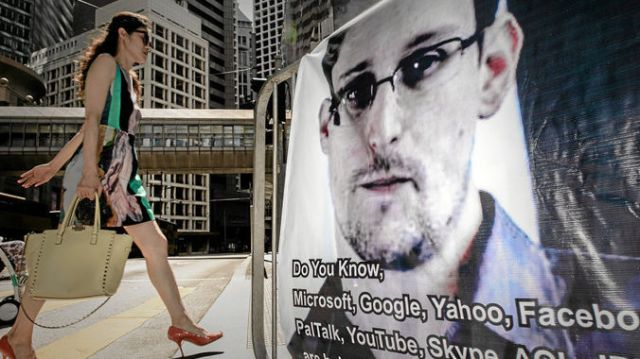 Edward Snowden, form government contracter turn whistleblower, on a banner in Hong Kong, Source: PHILIPPE LOPEZ/AFP