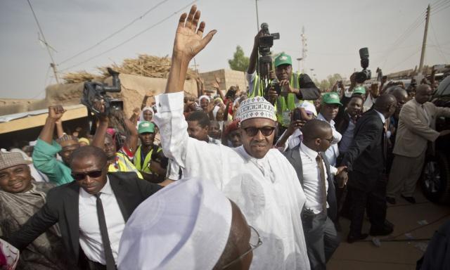 Muhammadu Buhari waves in his hometown of Daura in northern Nigeria, Source: Ben Curtis/AP