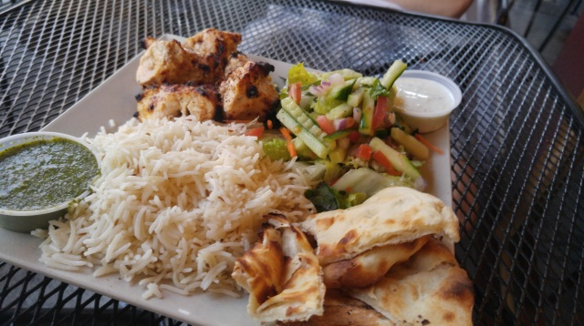 Chicken Kebab with Naan, Chutney, and a salad.